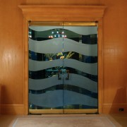Two leaf, sandblasted interior door with railing